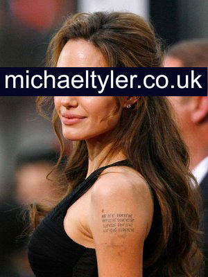Angelina Jolie - tattoo with coordinates of the birth places of her children