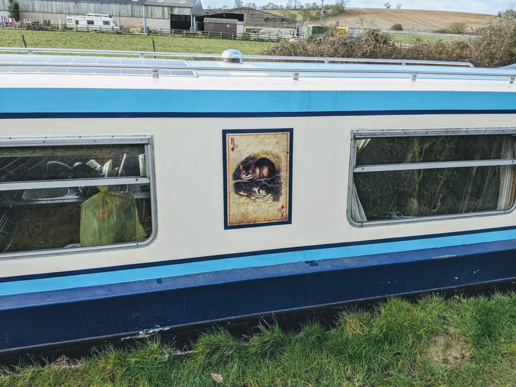 Painting a narrowboat.