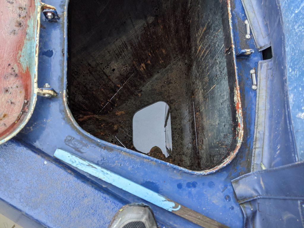 Empty narrowboat water-tank
