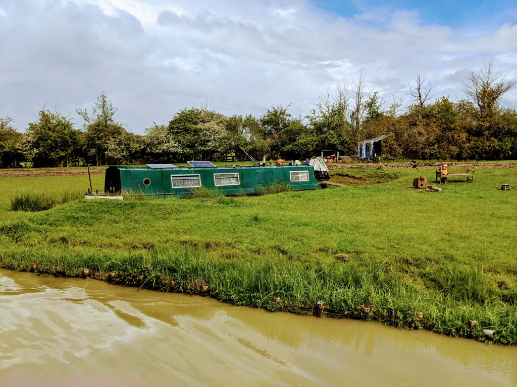 Narrowboat moored trapped in a field.