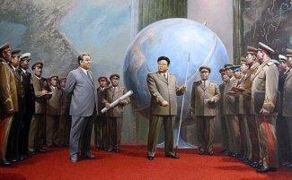kim-jong-il-propaganda-posters-10-giant-globe-surrounded-by-military-560x346_6575216431_l.jpg