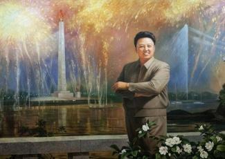 kim-jong-il-propaganda-posters-11-smiling-juche-tower-560x396_6575216551_l.jpg